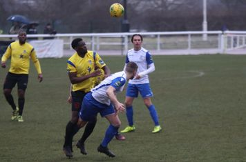 Enfield's Brad Wadkins (white, L) and Sam Youngs and Kingstonian's Freddy Yao and Rob Bartley (L)