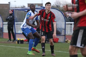 Enfield's Junior Mubiayi (L), who made his debut as a late substitute, and Brightlingsea's George Keys