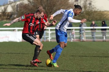 Brightlingsea's Terry Amass (L) and Enfield's Dernell Wynter