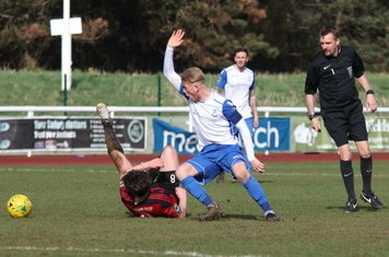 Enfield's Ryan Blackman (white) appeals for a handball by Thomas Dunningham. Referee Tim Donnellan disagrees.