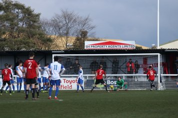 Enfield keeper Joe Wright collects a weakly-struck free kick