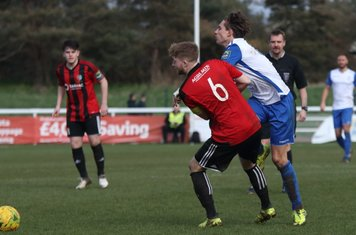 Brightlingsea's Matt Cripps (6) and Enfield's Sam Youngs
