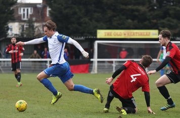 Enfield's Sam Youngs and Brightlingsea's Jake Turner (4) and Michael Gage