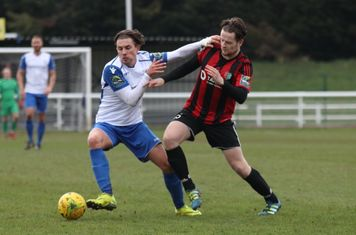 Enfield's Sam Youngs (L) and Brightlingsea's Michael Gage