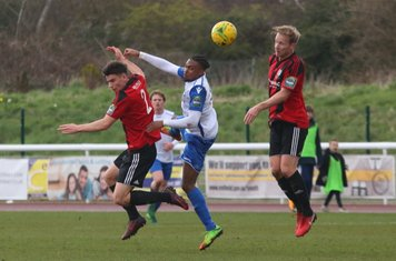 Brightlingsea's George Keys (L) and Terry Amass and Enfield's Dernell Wynter