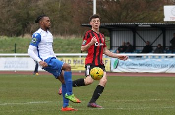 Enfield's Dernell Wynter (L) and Brightlingsea's George Keys