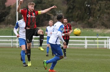 Brightlingsea's Josh Gould (red/black) and Enfield's Dernell Wynter