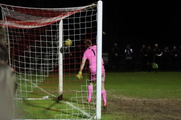 Dorking keeper Slavomir Huk can only look on as a cross rebounds off the far post