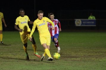 Enfield's Liam Hope and Junior Mubiayi and Dorking's James McShane