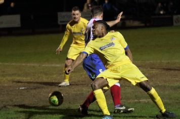 Enfield's Dernell Wynter (R) and Liam Hope and Dorking's David Ray