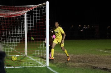 Enfield's Simon Thomas celebrates after Dorking keeper fumbles a harmless cross into his own goal - Thomas was nowhere near at the time