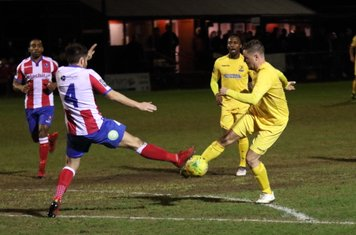 Enfield's Liam Hope (R) drags the ball past the challenge of Dean Hamlin to set up a shooting chance