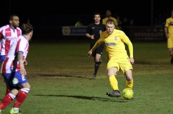 Enfield's Brad Wadkins and Dorking's Jerry O'Sulliavn (2) and Jerome Beckles