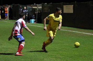 Dorking's Anthony Oakes (L) and Enfield's Samir Bihmoutine