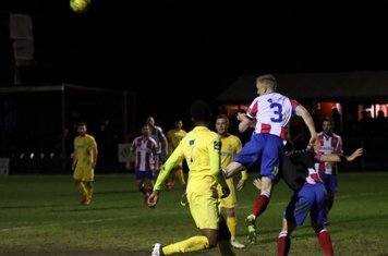 Dorking's Chris Boulter heads clear