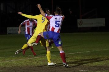 Enfield's Liam Hope (L) and Dorking's David Ray