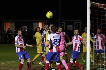 All eyes on the ball as it curls wide of the post