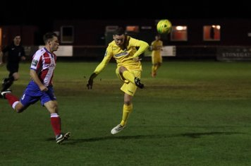 Enfield's Liam Hope (R) sends an attempted lob over the crossbar