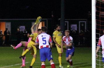 Dorking keeper Slavomir Huk catches under pressure