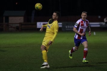 Enfield's Liam Hope (L) and Dorking's Chris Boulter