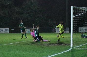 Simon Thomas scores the final Enfield goal