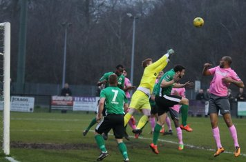 Burgess Hill's Josh James punches clear