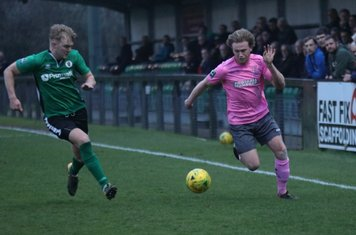 Burgess Hill's Pat Harding (L) and Enfield's Aaron Greene