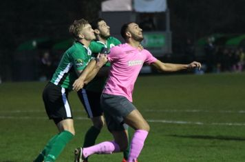 Burgess Hill's James Richmond (L) and Gary Elphick and Enfield's Mat Mitchel-King