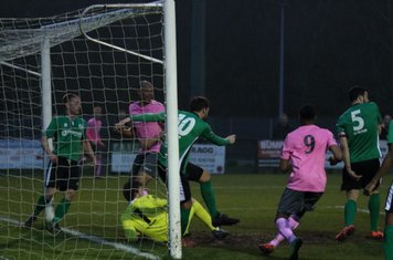 Burgess Hill's Jack Brivio (10) clears off the line