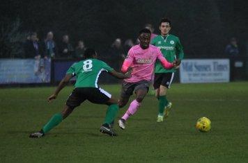 Enfield's Ryan Blake (pink) runs at Ibrahim Diallo