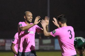 Simon Thomas (L) celebrates the first o his two goals