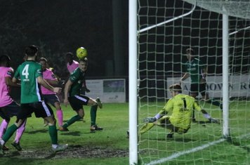 Burgess Hill keeper Josh James saves from Liam Hope