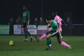 Enfield's Junior Mubiayi (pink) challenges Conor Tighe