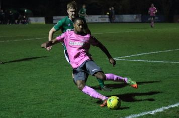 Enfield's Dernell Wynter (pink) and Burgess Hill's James Richmond