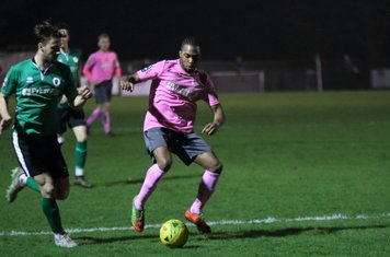 Burgess Hill's Tom Cadman (L) and Enfield's Dernell Wynter