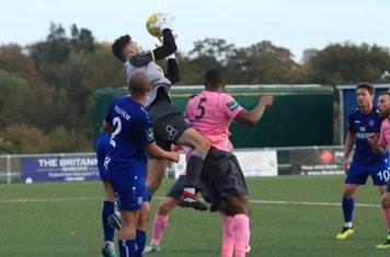 Margate keeper Henry Newombe catches under pressure from Taofiq Olomowewe