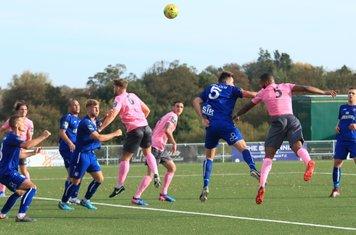 Enfield's Taofiq Olomowewe (pink no 5) heads narrowly wide