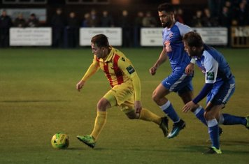 Enfield's Lewis Taaffe and Tonbridge's Joe Turner and Jack Parter (R)