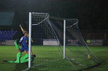 Billy Bricknell (yellow) celbrates as Taofiq Olomowewe's header puts Enfield 2-0 up