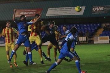 Taofiq Olomowewe (yellow/red) puts Enfield 2-0 ahead