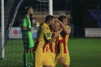 Enfield scorer Ryan Blackman celebrates with Billy Bricknell (L) and Aaron Greene