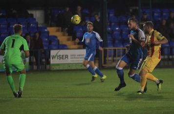 Tonbridge's Arthur Lee (blue) and keeper Jon Henly and Enfield's Billy Bricknell