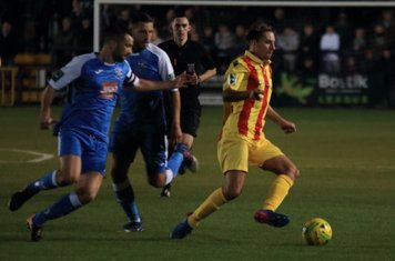 Enfield's Sam Youngs and Tonbridge's Tom Parkinson (L) and Craig Stone