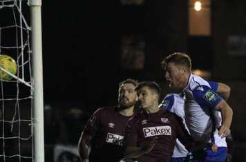Marc Weatherstone (R) heads the winning goal