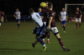 Enfield's Billy Bricknell (9) challenges James Budden