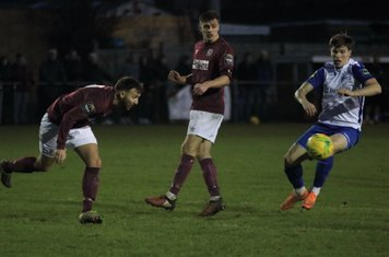 Potters Bar's Andrew Lomas (L) heads clear from Josh Davison