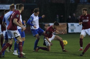 Enfield's Sam Youngs (white. centre) challenges Sean Grace