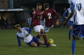 Enfield's Dan Rumens challenges Andrew Lomas and Lewis Hobbs (2)