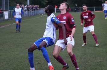 Enfield's Muhammadu Faal (L) and Potters Bar's Sean Grace jostle for position under a high ball