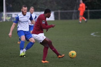 Potters Bar's Stefan Powell (R) clears from Sam Hatton